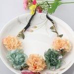 Bloemen haarband groen/zalm
