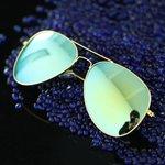 Zonnebril goud/geelgroen