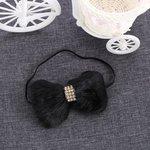 Elastische haarband bont strik - zwart