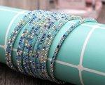 Set van 5 elastische armbanden met blauwe strass stenen