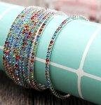 Set van 5 elastische armbanden met gekleurde strass stenen