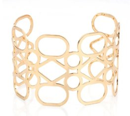 Brede open bangle armband - goudkleurig
