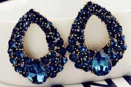 Goudkleurige oorbellen blauwe strass