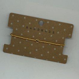 Armbandje gold beads