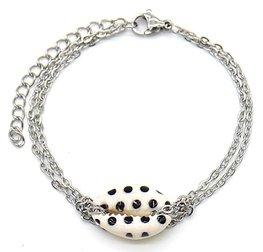Armband schakel schelp stip - Zilver