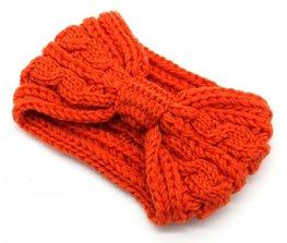 Knitted bow headband - Oranje