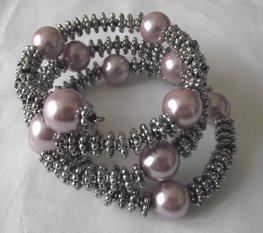 Spiraal armband roze/zilver