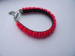 Rubber spike armband neon roze/neon oranje