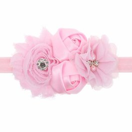 Elastische haarband met 3 bloemen roze