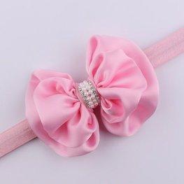 Elastische haarband strik met parels - roze