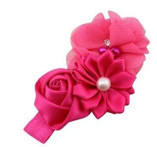 Baby haarband met 3 verschillende bloemen hard roze