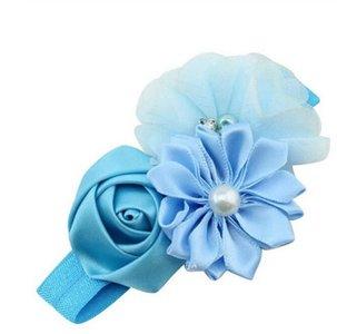 Baby haarband met 3 verschillende bloemen , blauw