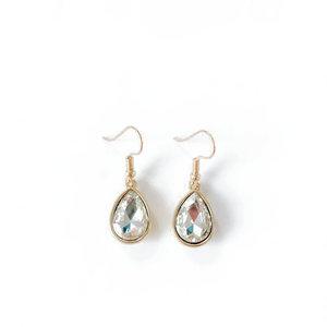 Oorbellen , goudkleurig met blanke kristal steen