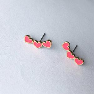Oorbellen hearts goud/roze