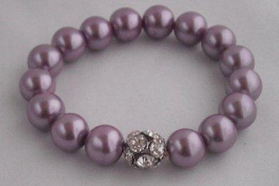 Elastische parel armband met strass bal lila