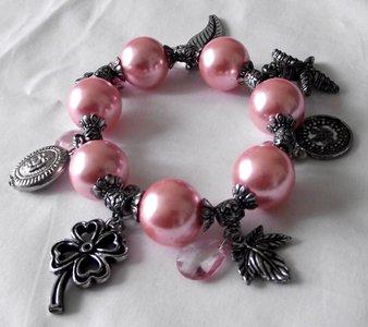 Elastische kralen armband roze/zilver