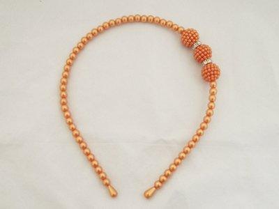 Parel/strass haarband - oranje