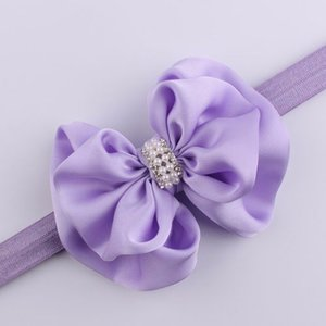 Elastische haarband strik met parels - paars