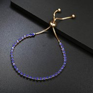 Armband goudkleurig met 1 rij blauwe strass